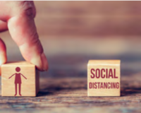 Social distancing depicted by wooden blocks