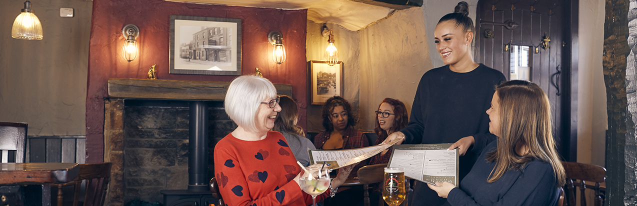 Inside a Marston's pub - customers being served by table staff