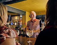 Landlord behind a bar