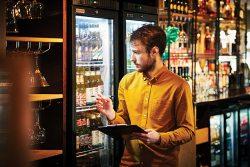 Man stock-checking in a bar/pub